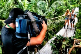 """Kingsley Haxton filming hosts Laura Whitmore and Joe Swash. """"I'm a Celebrity Get Me Out of Here, Now!"""" ITV2, 2012"""